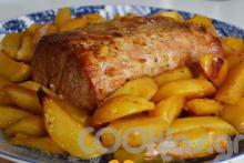 Μπούτι χοιρινό με πορτοκάλι και πατάτες